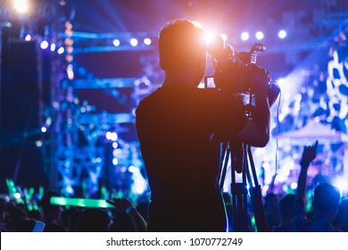Cameraman shooting video action film production camera videographer in concert music festival