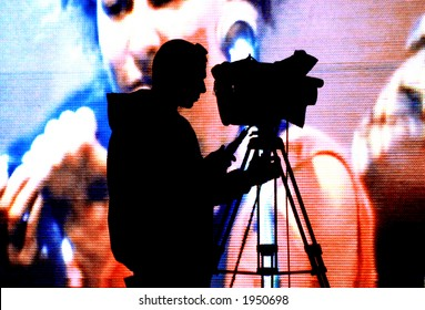 cameraman silhouette on a huge screen