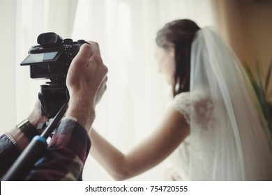 the cameraman takes off the wedding