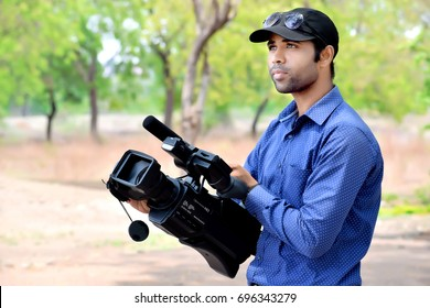 cameraman using a professional camcorder outdoor filming documentary