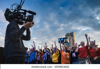 Cameraman's work at the concert.Kiev, Ukraine - May 19, 2018 : Cameraman operator works at a music concert in the open air. Fan girls at a concert in the open air