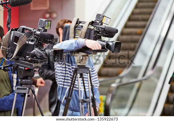 Cameramen with their equipment at shooting