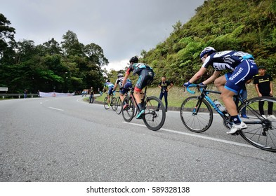 Cameron Highland, Malaysia. 25 feb 2017. Unidentified riders in full effort arrive at the intermediate for King Of Mountain during the stage 4 of Tour de Langkawi in cameran highland on feb 25, 2017