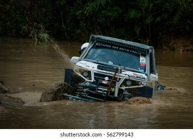 CAMERON HIGHLANDS, MALAYSIA - DECEMBER 02, 2016: Rainforest challenge offroad race. Muddy river stage