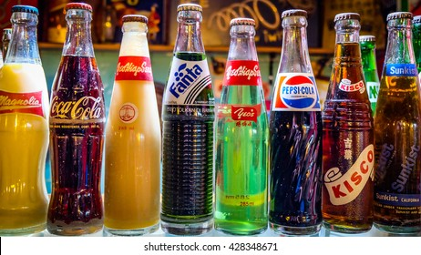 CAMERON HIGHLANDS, MALAYSIA - JANUARY 2016: Collection of original unopened vintage soft drinks. These bottles with Coca Cola, Pepsi, Fanta, Kisco, Magnolia and Sunkist were imported by british army.