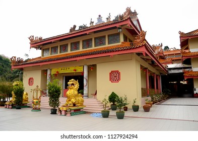 Cameron Highlands, Malaysia - June 6, 2017: A lion Foo Dog guards the entrance doorway to one hall of the Sam Poh Chinese Buddhist temple in Brinchang. The temple was completed in 1972.