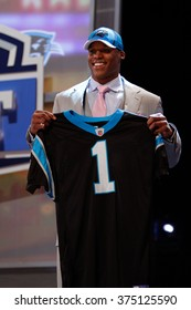 Cameron Newton (R) is introduced as the first pick to the Carolina Panthers at the NFL Draft 2011 at Radio City Music Hall in New York, NY.