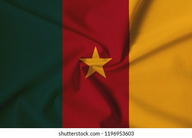Cameroon flag, with a fabric texture