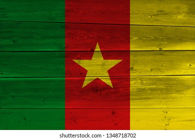 Cameroon flag painted on old wood plank. Patriotic background. National flag of Cameroon