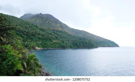 Camigin Bay. The calm sea Bohol and the majestic volcanoes Kamigina. Camiguin, Philippines.