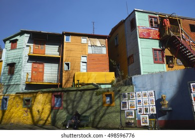 CAMINITO, LA BOCA, BUENOS AIRES, ARGENTINA - JULY 2016: Street scene with the Cultural Center and art market at sunset in the old artistic La Boca neighborhood.