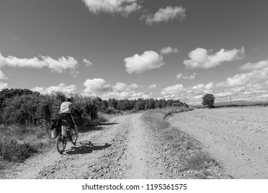 CAMINO DE SANTIAGO, SPAIN - AUGUST 8, 2018 - A pilgrim in bike along the way of St.James, in the spanish meseta
