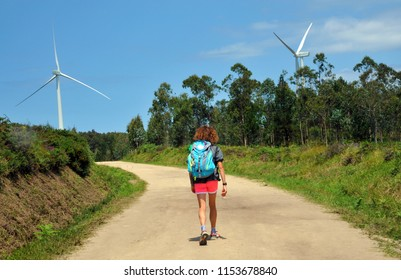 CAMINO DE SANTIAGO, SPAIN - JULY 18, 2018:Pilgrims with backpacks, walking the Camino de Santiago, camino portugues