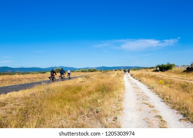 Camino de Santiago (Spain) - Pilgrims and bikers along the way of St.James, in the spanish meseta