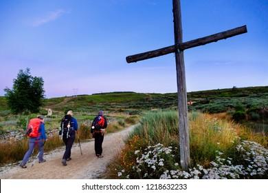 Camino de Santiago (Spain) - Pilgrims  walking along the way of St.James in the Bierzo landscape
