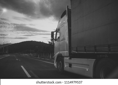 Camion, van rides along the road in evening, rear view. argo van, truck, kamion transports goods or items between countries. International transportation concept.