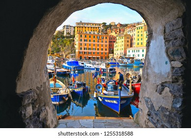 Camogli (GE), Italy 15.03.2017. Detail of  harbour with fishing boats and fishermans arch window  in the old village of Camogli, Gulf of Paradise, Portofino National Park, Genova, Liguria, Italy