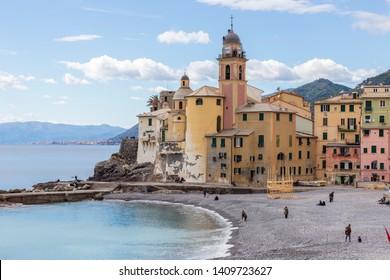 Camogli, Italy. 04-29-2019. Beach and colored houses at Camogli. Liguria. Italy.