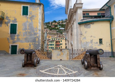 Camogli, Italy. 04-29-2019.  Canons and  old colored houses at Camogli. Liguria. Italy.