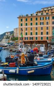 Camogli, Italy. 04-29-2019. Fish boats and colored houses at Camogli. Liguria. Italy.