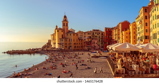 Camogli, Italy - 07 November 2015. Scenic Mediterranean riviera coast. Panoramic view of Camogli town in Liguria, Italy. Basilica of Santa Maria Assunta and colorful palaces.
