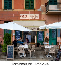 CAMOGLI, ITALY - APRIL 24, 2019 : Wine bar  in old colorful building  of Camogli town, Italy.