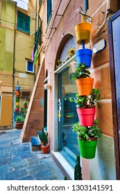Camogli, Italy, a coastal town on the Italian riviera, offers colorful views from the street cafe restaurant.  It is a welcoming location for tourists on travel vacation.