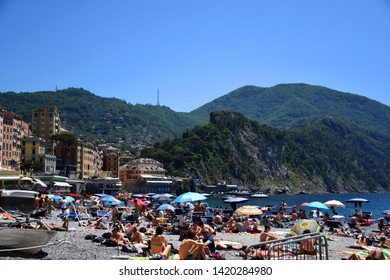 Camogli, Italy – June 2, 2019: Cityscape and beach photos of the small fishing village and tourist resort Camogli, located on the west side of the peninsula of Portofino in Italy