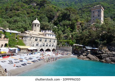 Camogli, Italy - May 15th, 2017: San Fruttuoso Abbey, a Catholic medieval abbey situated in the charming small bay of Capodimonte, accessible only by foot or by sea.