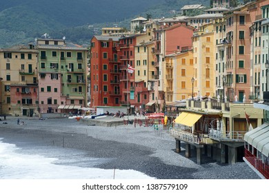 Camogli, Italy - May 31st, 2016: Camogli at the coast of Italy in beautiful sunlight with dark clouds in the air