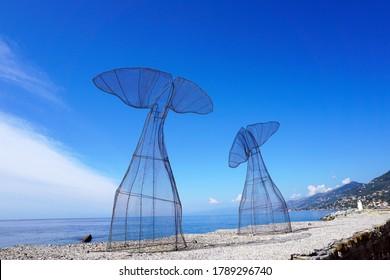 Camogli, Italy - September 10, 2018 / Metallic Whale Tail Statue by The Ligurian Sea.