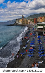 CAMOGLI, ITALY/EUROPE - SEPTEMBER 3, 2018:  Camogli, Italy is one of the towns along the Italian Riviera that is a popular vacation travel destination.  People relax and sunbathe on the beach.