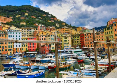 CAMOGLI, ITALY/EUROPE - SEPTEMBER 3, 2018:  Camogli, Italy is one of the towns along the Italian Riviera that is a popular vacation travel destination.  Boats and yachts dock in the harbor.