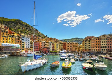 Camogli marina harbor, boats and typical colorful houses. Travel destination Ligury, Italy, Europe.