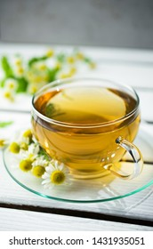 Camomile infusion in glass, natural medicine, Phytotherapy