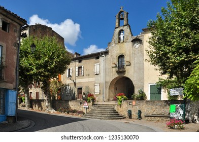 CAMON, ARIEGE, FRANCE - September 10, 2018. Village centre with the Porte de l'Horloge or Clock Gate in the fortified village of Camon, Ariege, Occitanie, France