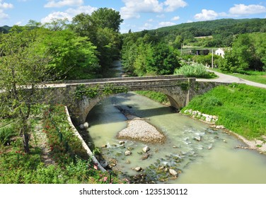 CAMON, ARIEGE, FRANCE - September 10, 2018. Road bridge over the River Hers, Camon, Ariege, Occitanie, France