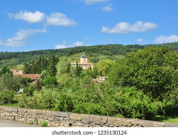 CAMON, ARIEGE, FRANCE - September 10, 2018. Woodland and the Chateau de Camon in the rural village of Camon, Ariege, Occitanie, France
