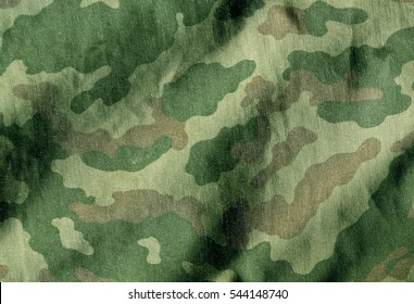 Camouflage cloth surface. Abstract background and texture for design and ideas.