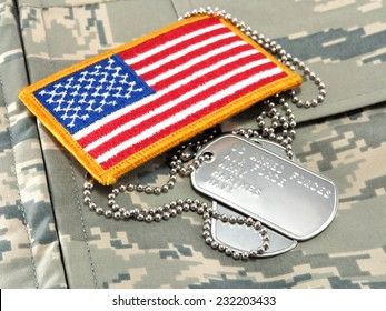 Camouflage uniform, dog tags, American Flag