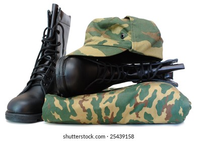 Camouflage uniform and two black leather army boots on isolated (white) background.