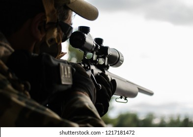 Camouflage wrap tape on sniper rifle and scope close up