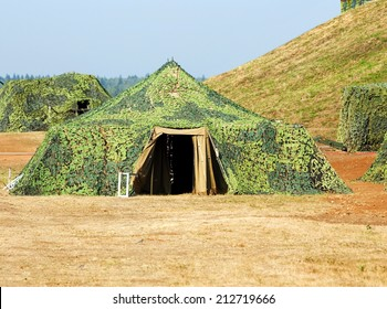 Camouflaged military tent at the military training camp