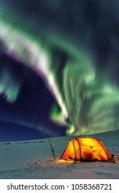 Camp with Aurora Borealis
