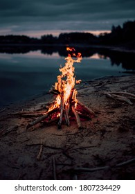 Camp bonfire near the lake .