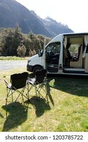 Camp chairs outside a campervan in the Fjordland National Park