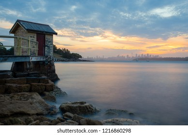 Camp Cove, Sydney, Australia. Sunset over the city skyline at the famous Watsons Bay on Sydney Harbour.