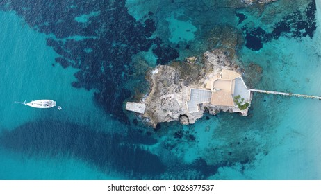 Camp de Mar, Andratx, Balearic Islands, Spain 02/17/2018: Aerial image of the island located in Camp de Mar in which the restaurant La Illeta is located, well known in the area for its spectacular pae