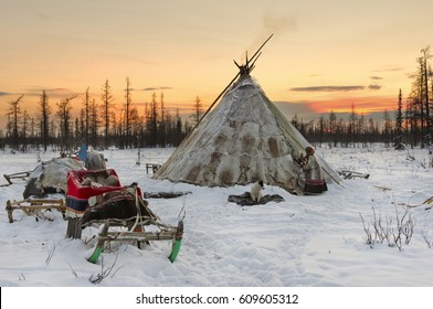 Camp of nomadic tribe in the polar tundra at a frosty day. Chum, sled and other stuff.