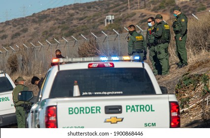 Camp Pendleton, CA  USA 12-02-2020: Border Patrol agents and Police detain a suspect on the side of the 5 freeway near Camp Pendleton Ca